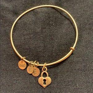 Goldtone Alex and Ani bracelet with locket charm